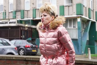 Diane Morgan in character as Mandy, in a bright pink quilted jacket with a furry collar