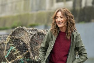 Orla Brady by a harbour as Kate Ryan in The South Westerlies