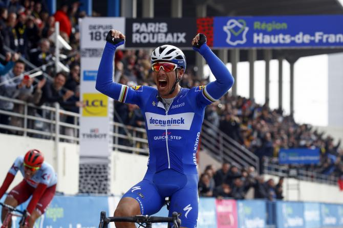 Philippe Gilbert celebrates as he wins Paris-Roubaix