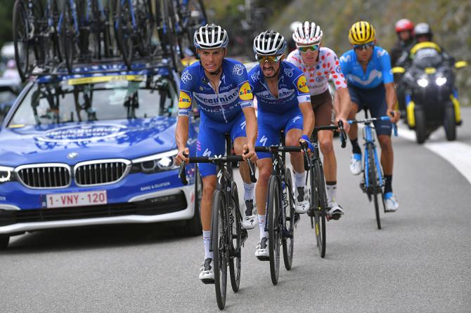 Enric Mas helping Julian Alaphilippe (Deceuninck-QuickStep) during stage 20 at the Tour de France