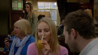 Belle shares a drink with Jamie in Emmerdale