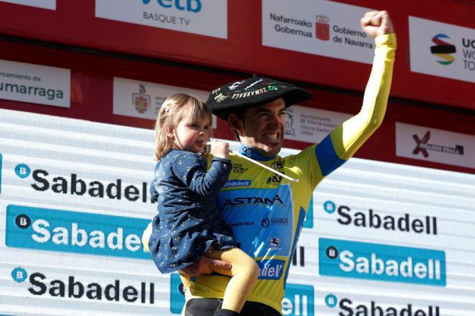 Ion Izagirre celebrates on the podium with his daughter