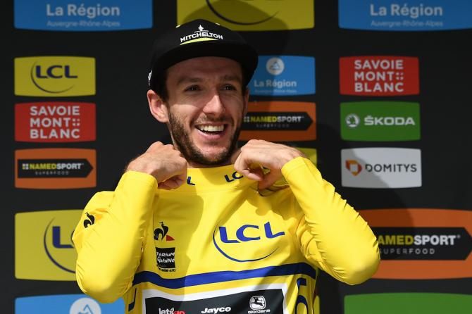 Adam Yates pulls on the yellow jersey after stage 6 at Dauphine