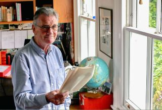 Michael Palin poses with a globe for his new BBC2 series Michael Palin's Travels