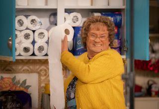 Mrs Brown gleefully stashing toilet roll
