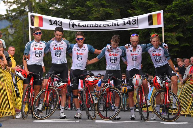 Lotto Soudal line across the finish line of stage 4 for a moment of silence in memory of their teammate Bjorg Lambrecht at the Tour de Pologne