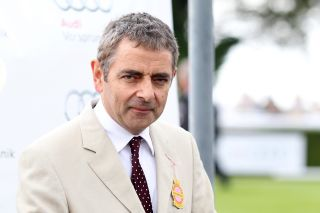 Rowan Atkinson in a cream suit at the races