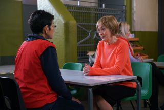 Yasmeen Nazir with a mystery visitor in prison in Coronation Street
