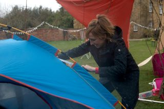Laurel rescues Dottie from a burning tent in Emmerdale