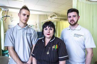 Volunteer Finlay Roberts, Senior Nurse Karen Hill and volunteer Michael Lowe in Elderly Ward at The Royal Derby Hospital