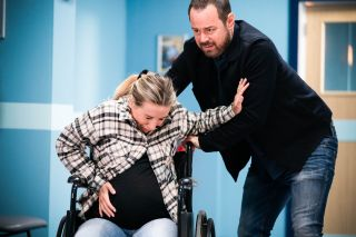 Mick Carter helps a pregnant Jeanette in EastEnders