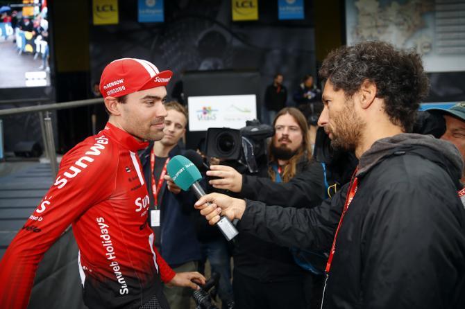 Team Sunweb's Tom Dumoulin talks with reporters