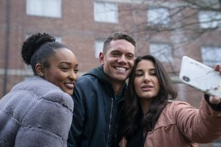 Tom Brittney as Billy Fearon, posing for a selfie with fans in the drama