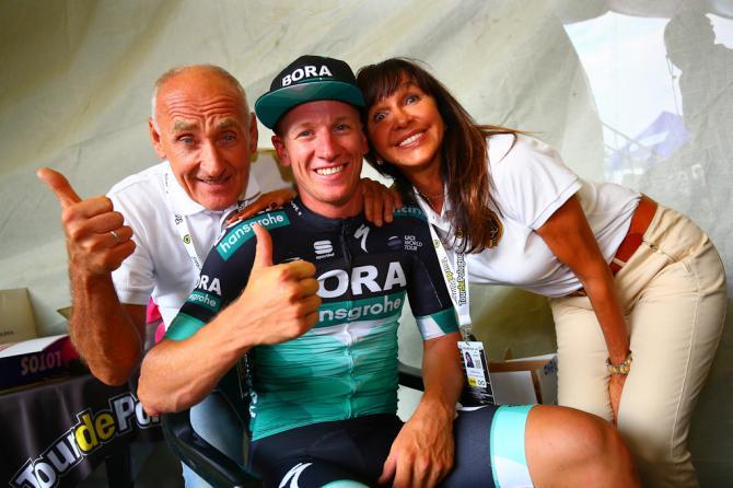 Pascal Ackermann celebrates winning stage 1 in Poland