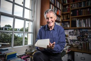 Michael Palin looks through his notes from his travels