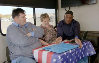 Mark Wallace, Anne Hegarty and Shaun Wallace tackle a puzzle in their Winnebago