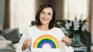 Shirley Ballas holding up a drawing of a rainbow on Dear NHS Superstars