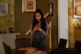 Coronation Street spoilers: Asha Alahan looks at the picture on her phone in horror