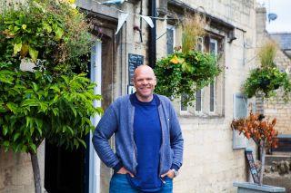 Tom Kerridge standing outside The Prince Albert in Stroud