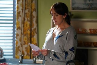 Sonia Fowler reads a letter in EastEnders
