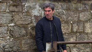 Cain is convinced Malone and Moira are having an affair in Emmerdale