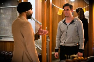 Kheerat prises Zack away from a client in EastEnders