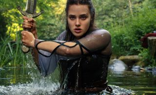 Katherine Langford emerges from a lake brandishing a sword in Netflix's Cursed